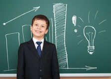 Boy in suit show graphs on school board Royalty Free Stock Photo