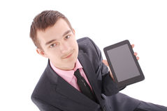 Boy in a suit sitting and holding a tablet PC Stock Photo