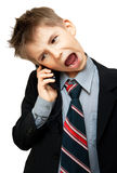 Boy In Suit Yelling. Into Cellphone over white background Royalty Free Stock Photos