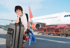 The boy with  suitcase. The boy with  gray suitcase and flippers Stock Photos