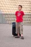 Boy with suitcase Stock Images