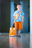 Boy with suitcase at airport Stock Image