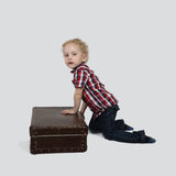 Boy with suitcase Stock Photo