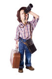 Boy with suitcase looking to spyglass Stock Image