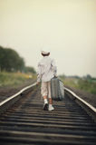 Boy with suitcase on railroad Stock Photography
