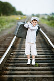 Boy with suitcase on railroad Stock Photos