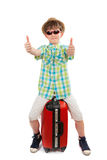 Boy with a suitcase shows the gesture fine Royalty Free Stock Photo