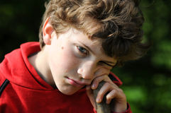 Boy sulking Royalty Free Stock Photos