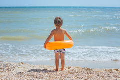 Boy on the summer beach Stock Photos