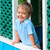 Boy in the summer house Royalty Free Stock Image