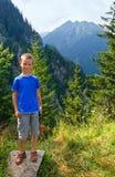Boy in summer mountain (Romania). Royalty Free Stock Photos