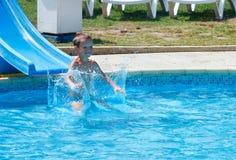 Boy in summer outdoor pool. Stock Photos
