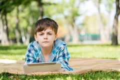 Boy in summer park Royalty Free Stock Images