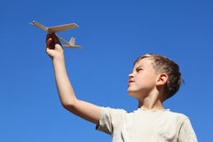 Boy in summer plays with model of airplane Royalty Free Stock Image
