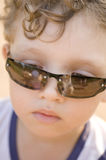 Boy in sun glasses close up Stock Photos
