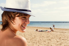 Boy with sun lotion on shoulder Stock Photography
