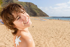 Boy with sun lotion on shoulder Royalty Free Stock Photo