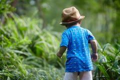 Boy  in sun straw-hat Stock Photos