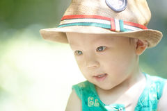 Boy  in sun straw-hat Stock Photography