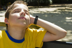 Boy sunbathing in the sun Stock Image