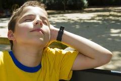 Boy sunbathing in the sun stock image