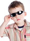 A boy in the sunglasses Stock Images