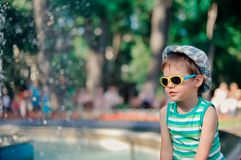 The boy in sunglasses Stock Photography