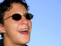 Boy with sunglasses stock photo