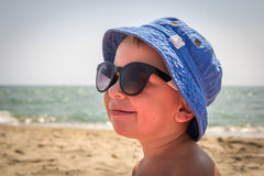 Boy in sunglasses on the beach Royalty Free Stock Photos
