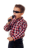 Boy in sunglasses singing Royalty Free Stock Photography