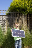 Boy (4-6) in sunglasses with solar panel in garden, portrait Royalty Free Stock Photography