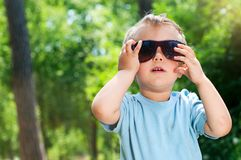 Boy Sunglasses in the summer park Stock Photography