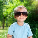 Boy Sunglasses in the summer park Royalty Free Stock Image