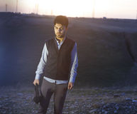 Boy at sunset. Brunette boy in Iraqi countryside near Erbil city at sunset Royalty Free Stock Photography