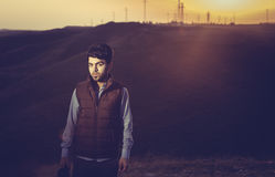 Boy at sunset. Brunette boy in Iraqi countryside near Erbil city at sunset Stock Photography