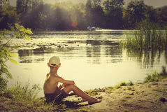 Boy at sunset, summer concept image Royalty Free Stock Photography