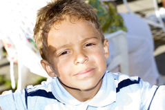 Boy in Sunshine. Close-up portrait of a young boy Stock Image