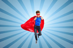 Boy in super hero cape and mask showing thumbs up Stock Photos
