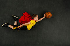 Boy superhero basketball player Stock Image