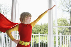 Boy In Superhero Costume With Arm Extended Royalty Free Stock Photos