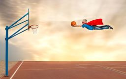 A boy in a superhero costume plays basketball and flies to throw the ball into the basket. stock images