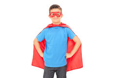 Boy in a superhero costume posing. Isolated on white background Royalty Free Stock Image