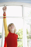 Boy In Superhero Costume With Raised Fist Looking Up Royalty Free Stock Photo