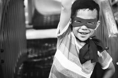 Boy Superhero Dressup Aspiration Playground Concept. Boy Superhero Dressup Aspiration Playground Stock Photography