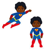 Boy superhero in flight and in standing position. Royalty Free Stock Image