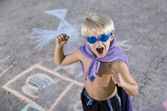 Boy superhero with mask and cape Stock Photos