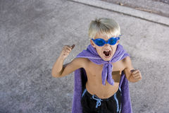 Boy superhero with mask and cape, shouting Stock Photography