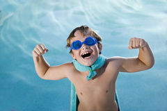 Boy superhero protecting the pool Royalty Free Stock Images