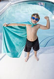 Boy superhero protecting the pool Royalty Free Stock Photography