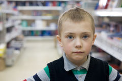 Boy in a supermarket Royalty Free Stock Photography